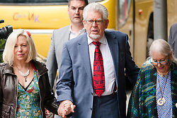London, June 27th 2014. Rolf Harris, on trial for indecent assault against 4 girls aged between 7 and 19 arrives with his daughter Bindi and his wife Alwen, at court where the jury is beginning a 7th day in retirement.