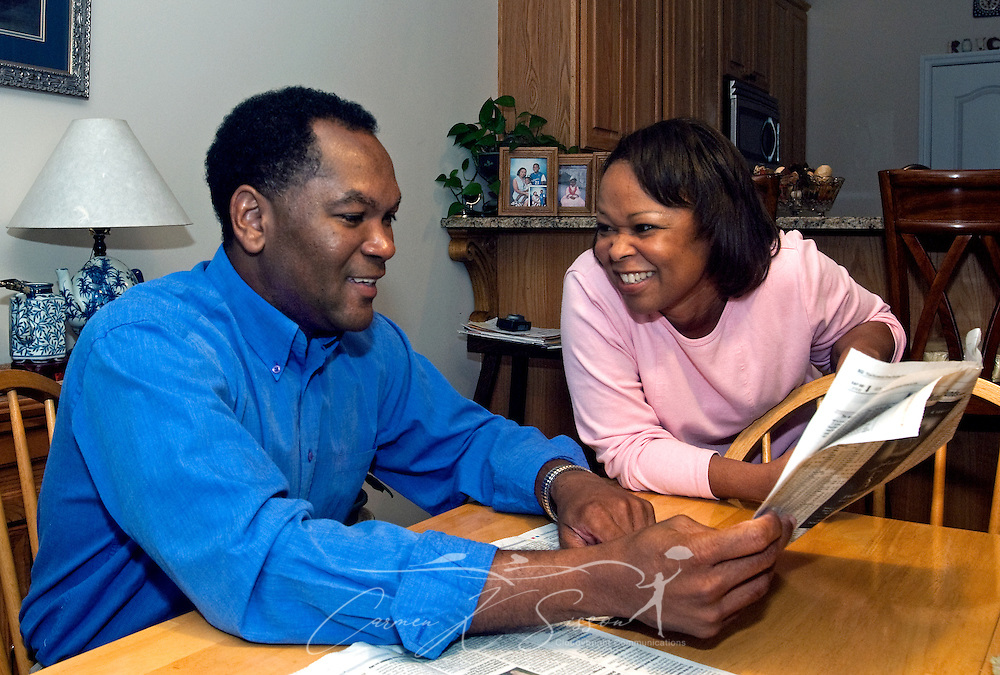 Levern Eady and his wife, Veda, talk over the real estate section in the kitchen of their home in Madison, Ala. Oct. 27, 2009. The Eadys chose to relocate to the Huntsville metropolitan area for the intellectually-rich environment it provides for their children as well as its future economic potential. Analysts expect Huntsville to fare well in the new economy thanks to its strong aerospace, defense, and biotech industries. (Photo by Carmen K. Sisson/Cloudybright)