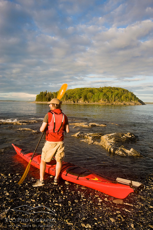 A kayaker in the Porcupine Islands in Maine's Acadia National Park.  Bar Harbor.