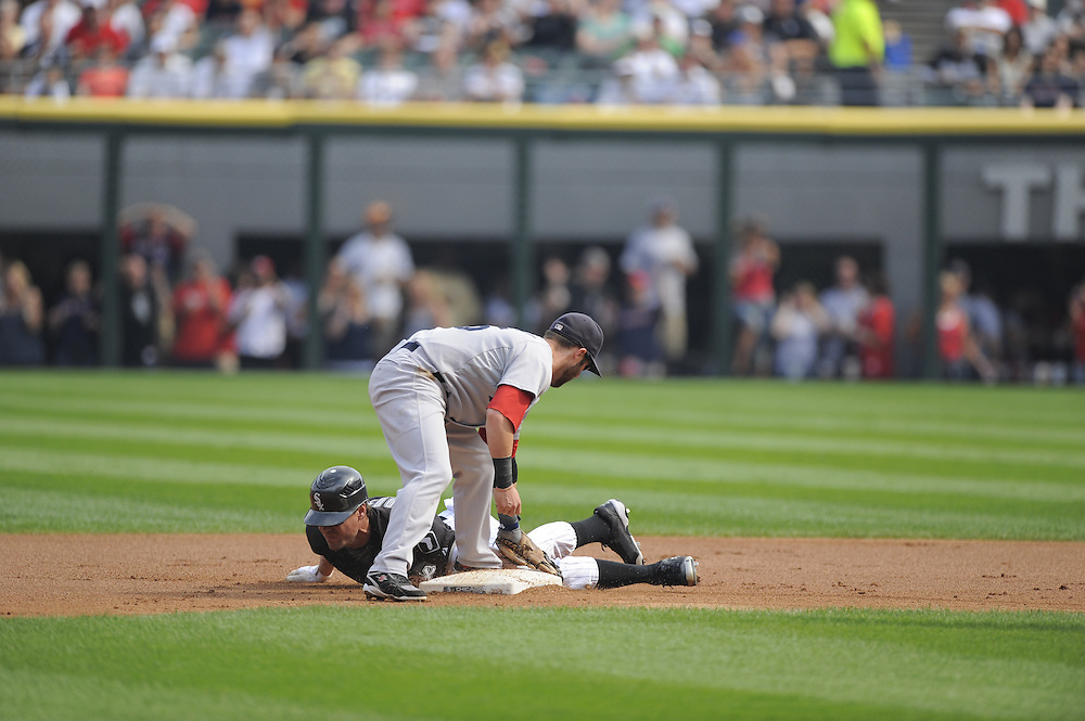CHICAGO - SEPTEMBER 5:  Scott Podsednik #22 of the Chicago White Sox steals second base under the late tag by Dustin Pedrioa #15 of the Boston Red Sox on September 5, 2009 at U.S. Cellular Field in Chicago, Illinois.  The White Sox defeated the Red Sox 5-1.  (Photo by Ron Vesely)