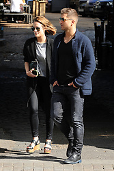 Caroline Flack and Strictly Come Dancing partner Russian Pasha Kovalev take a break from reahersals. The TV presenter supporting her new cropped hair and wearing Aviator Ray Ban shades, grey top, long black coat, black jeans and wedge shoes went for a spot of lunch before heading back to the dance studio. UK. 24/09/2014<br /> BYLINE MUST READ : JAMESY/KP/GOTCHA IMAGES<br /> <br /> Copyright by © Gotcha Images Ltd. All rights reserved.<br /> Usage of this image is conditional upon the acceptance <br /> of Gotcha Images Ltd, terms and conditions available at<br /> www.gotchaimages.com