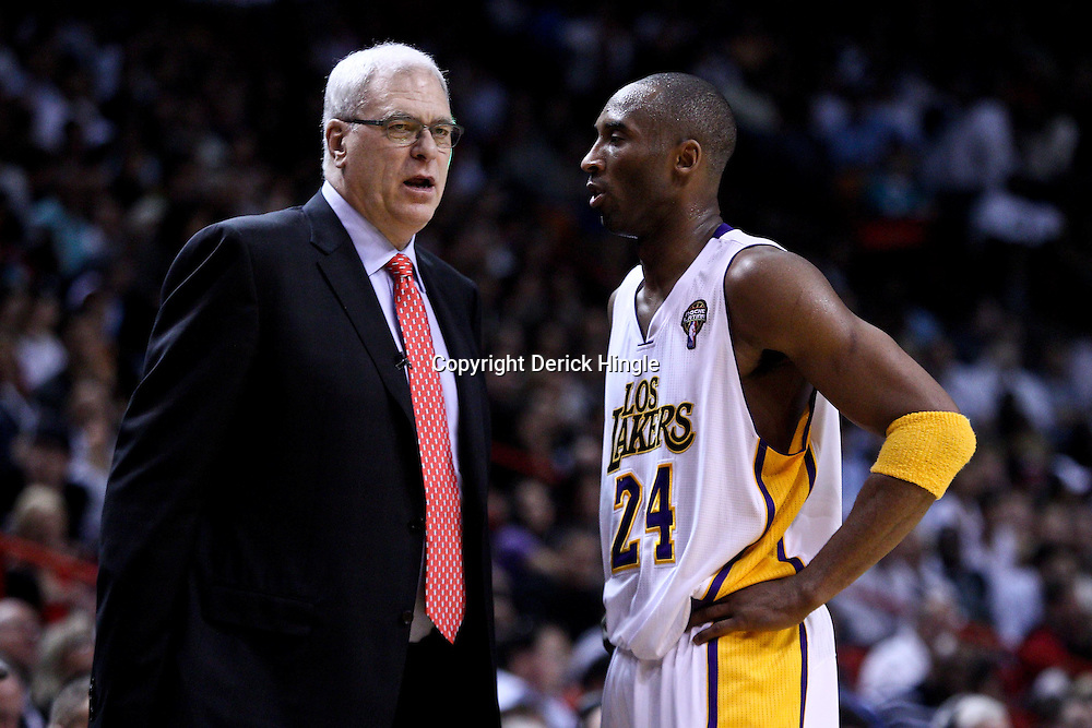 March 10, 2011; Miami, FL, USA; Los Angeles Lakers head coach Phil Jacksonand shooting guard Kobe Bryant (24) talk during the second quarter of a game against the Miami Heat at the American Airlines Arena.  Mandatory Credit: Derick E. Hingle