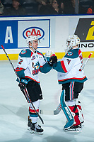 KELOWNA, CANADA - FEBRUARY 20: Brodan Salmond #31 celebrates a goal with Erik Gardiner #12 of the Kelowna Rockets against the Prince George Cougars on February 20, 2018 at Prospera Place in Kelowna, British Columbia, Canada.  (Photo by Marissa Baecker/Shoot the Breeze)  *** Local Caption ***