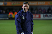 AFC Wimbledon goalkeeping coach Ashley Bayes warming up prior to kick off. during the EFL Sky Bet League 1 match between AFC Wimbledon and Ipswich Town at the Cherry Red Records Stadium, Kingston, England on 11 February 2020.