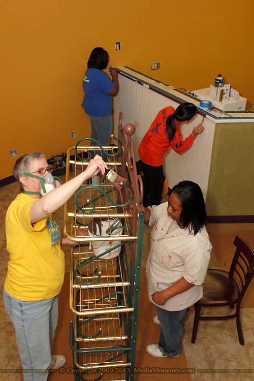 (from left) Lucinda Huff of Farmersville, Tracey Olinger of Clayton, Maria Cubol and Kenyatta McLemore of Dayton help the Ginghamsburg Church create a new church on East Main Street in Trotwood, Saturday, February 4, 2012.  The church church will share space with the YMCA.