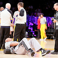 19 March 2014: San Antonio Spurs forward Boris Diaw (33) talks to Senior Director of NBA Photos, NBA Entertainment, Andrew D. Bernstein, official photographer for the NBA since 1986, prior to the San Antonio Spurs 125-109 victory over the Los Angeles Lakers at the Staples Center, Los Angeles, California, USA.