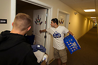3rd year student Samuel Avard(right) helps out 1st year student Hunter Judge during Move-In day at Lakes Region Community College Apple Ridge student apartments Sunday morning.  (Karen Bobotas/for the Laconia Daily Sun)