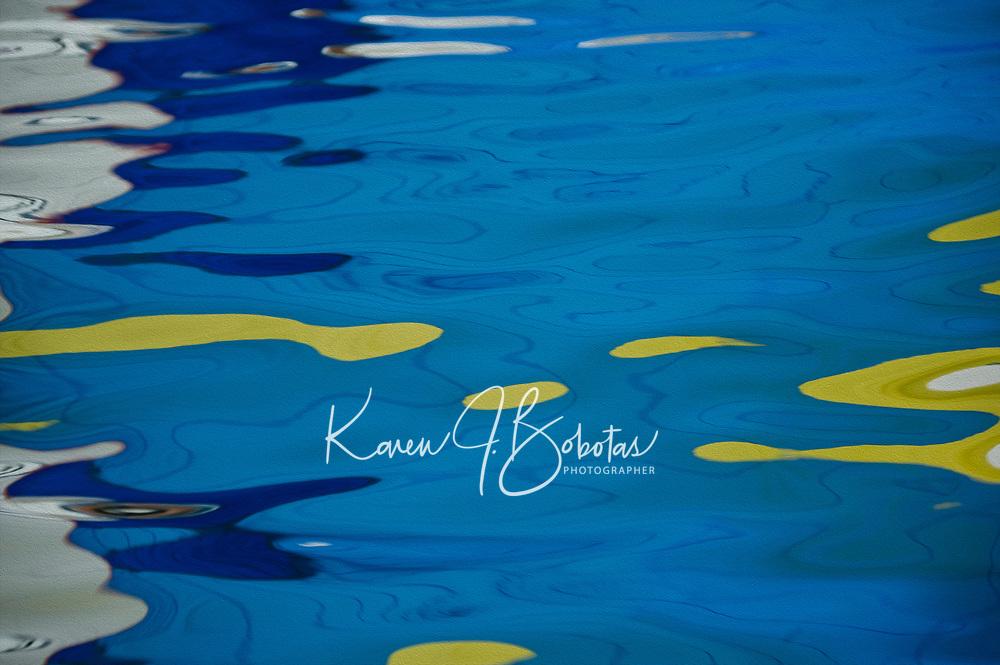 Sail reflection off the water.  ©2014 Karen Bobotas Photographer