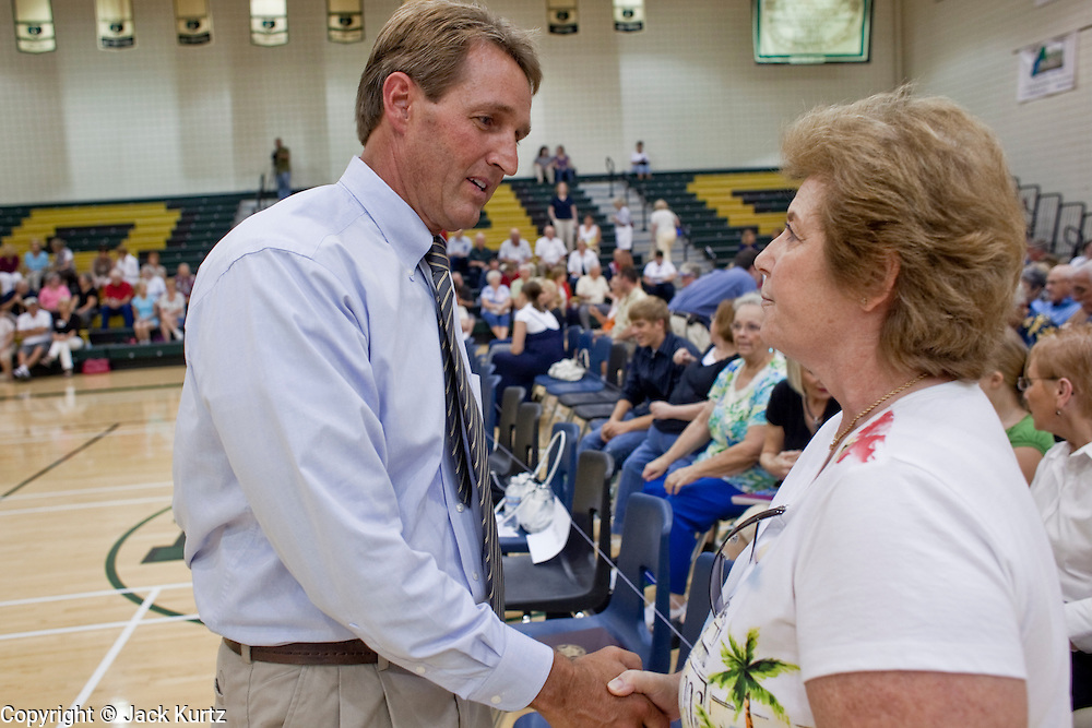 """Aug 10, 2009 -- CHANDLER, AZ: Rep. JEFF FLAKE talks to ROSE OWEN, from Gilbert AZ, before a town hall meeting on health care reform. Owen, a full time resident of Gilbert, said she is a Canadian citizen who is not happy with Canada's single payer system. She says her mother died waiting for a life saving operation in Canada. Rep. Flake, (R-AZ) hosted a """"town hall"""" style meeting on health care reform at Basha High School in Chandler Monday. Flake, a conservative Republican, has opposed President Obama on many issues, like the stimulus and health care reform. Protestors who have shut down similar meetings hosted by Democrats, gave Flake a warm welome. About 1,600 people attended the meeting.   Photo by Jack Kurtz"""