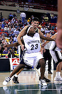 26 November 2005: MU junior Marques Alston (23) blocks out Mickey Michalec in the Monmouth University 54-62 loss to Oral Roberts University at the Great Alaska Shootout in Anchorage, Alaska