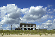 A beachfront home sits under cloudy skies, behind the sand dunes on Beach Drive, Wednesday, August 7, 2002, in Cape May, New Jersey. (Photo by William Thomas Cain/photodx.com)