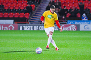 Danny Andrew of Doncaster Rovers (3) warming up wearing a Kick It Out t-shirt during the EFL Sky Bet League 1 match between Doncaster Rovers and Bristol Rovers at the Keepmoat Stadium, Doncaster, England on 26 March 2019.
