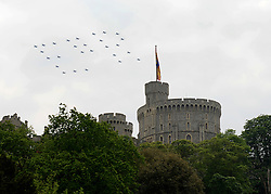 © Licensed to London News Pictures. 19/05/2012. WIndsor, UK 27 Hawks fly over Windsor Castle in the formation of ER to celebrate the Jubilee year. Armed Forces muster and parade in Windsor today , 19th May 2012, in tribute to Her Majesty the Queen for the Diamond Jubilee. 2,500 troops paraded through the town before the Queen and Duke of Edinburgh to mark the Diamond Jubilee. Once the parade has passed the Queen and Duke traveled along the same route to an arena within Home Park, where the troops mustered. A tri-service flypast of 78 aircraft, including helicopters, Hawks, the Battle of Britain Memorial Flight, the Red Arrows and Tornados went overhead. Photo credit : Stephen Simpson/LNP