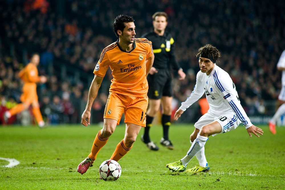 10.12.2013. Copenhagen, Denmark. Arbeloa (L) of Real Madrid fights for the ball with Bolaños (L) of FC Copenhagen during the UEFA Champions League match at the Parken Stadium. Photo: © Ricardo Ramirez.