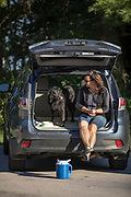 Judy Roemer and her dog Chica do a little tailgating at Point Beach State Forest near Two River, Wisconsin.