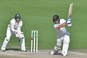 Laurie Evans drives watched on by Chris Read during the Specsavers County Champ Div 2 match between Sussex County Cricket Club and Nottinghamshire County Cricket Club at the 1st Central County Ground, Hove, United Kingdom on 28 September 2017. Photo by Simon Trafford.