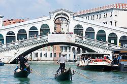 The famous historic Rialto Bridge crossing the Grand Canal in Venice Itlay
