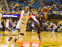 Feb 13, 2016; Morgantown, WV, USA; West Virginia Mountaineers guard Jevon Carter (2) guards TCU Horned Frogs guard Chauncey Collins (1) on a fast break during the first half at the WVU Coliseum. Mandatory Credit: Ben Queen-USA TODAY Sports