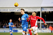 Peterborough Utd midfielder Ben White (6) cleans up under pressure from Charlton forward Karlan Ahearne-Grant (18) during the EFL Sky Bet League 1 match between Peterborough United and Charlton Athletic at London Road, Peterborough, England on 26 January 2019.