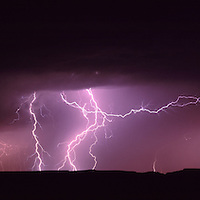 Africa, Namibia, Fish River Canyon National Park, Lightning storm over desert at rim of Fish River Canyon
