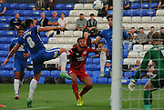 Peterborough scramble to deal with the loose ball during the Capital One Cup match between Peterborough United and Crawley Town at London Road, Peterborough, England on 11 August 2015. Photo by Michael Hulf.