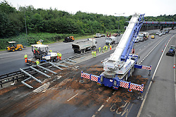© Licensed to London News Pictures. 06/08/2011 Reigate, UK. A section of the M25  between junction 7 and 8 being repaired today (06/08/2011) following a serious crash yesterday. Motorists endured a 28-mile tailback on the motorway yesterday after a crash  in which a lorry went through the central reservation and hit a car shut both carriageways. Photo credit : Grant Falvey/LNP