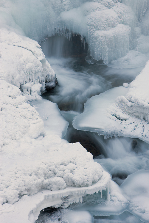 Frozen South Fork Waterfalls in Chugach State Park, Eagle River in Southcentral Alaska. Winter. Afternoon.