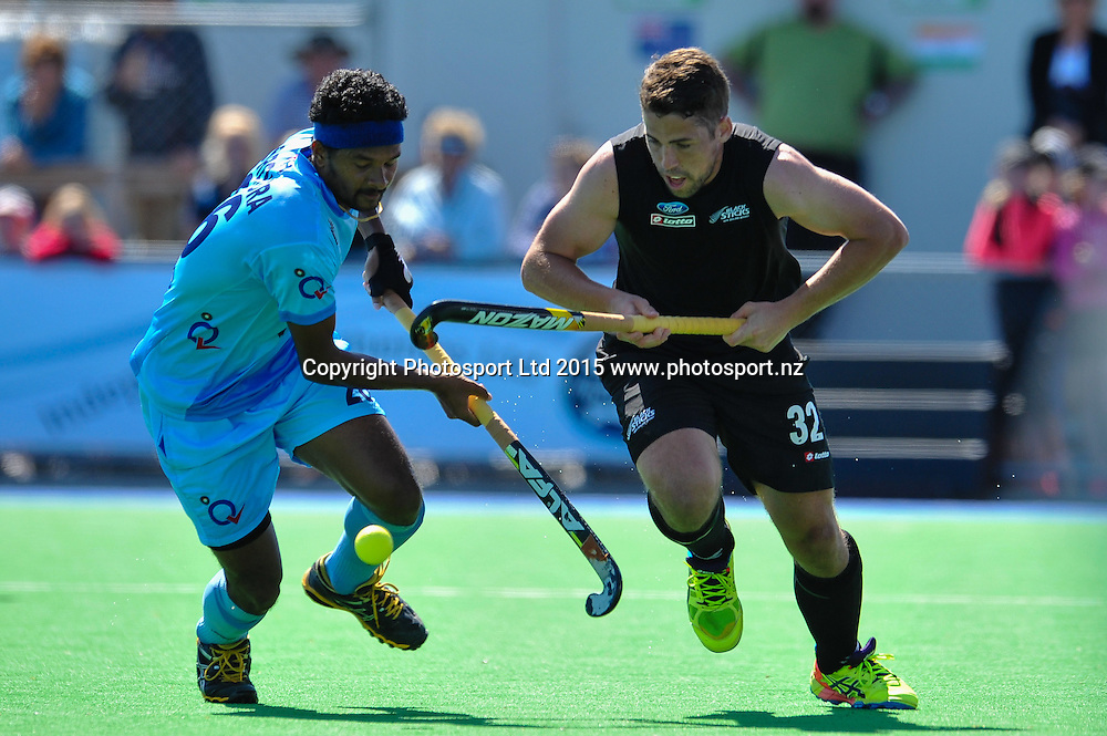Nick WILSON of the Black Sticks eludes Birendra Lakra of India during the Mens Hockey International, 2015 South Island Tour game between the New Zealand Black Sticks V India, at Marist Park, Christchurch, on the 11th October 2015. Copyright Photo: John Davidson / www.photosport.nz
