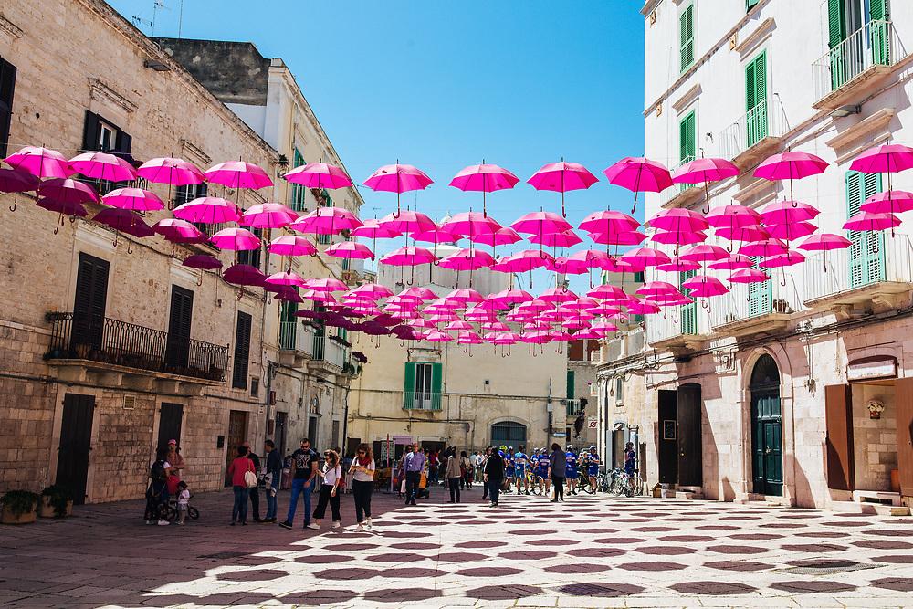 Molfetta was decorated with pink umbrellas for the 100th Giro start. Photo: Iri Greco / BrakeThrough Media | brakethroughmedia.com