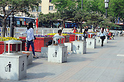 XI'AN, CHINA - APRIL 27: (CHINA OUT) <br /> <br /> Ten Garbage Cans Placed Within Fifty Meters<br /> <br /> Garbage cans line up near Kaiyuan Shopping Mall on April 27, 2015 in Xi'an, Shaanxi province of China. It was amazing that ten garbage cans were laid within fifty meters and reported from the Environmental Management of Xi'an's Beilin District that these garbage cans were put by a company who produced sanitation facilities. The management workers said that even there being so many garbage cans here, they could release much garbages in populated regions and they wouldn't remove them.<br /> ©Exclusivepix Media
