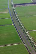 Nederland, Friesland, Gemeente Skarsterlan (Scharsterland), 01-05-2013; Haskerveenpolder tussen Joure en Akkrum. Weidegebied met uitzonderlijk open karakter. De polders hebben na de Tweede Wereldoorog een ruilverkaveling ondergaan met  betere waterhuishouding en rationeel indeling van de kavels als gevolg. Wederopbouwgebied.<br /> Land consolidation of the polder in Friesland (North Netherlands)    just after World War II for better water management and logic lots. Reconstruction area.<br /> luchtfoto (toeslag op standard tarieven)<br /> aerial photo (additional fee required)<br /> copyright foto/photo Siebe Swart