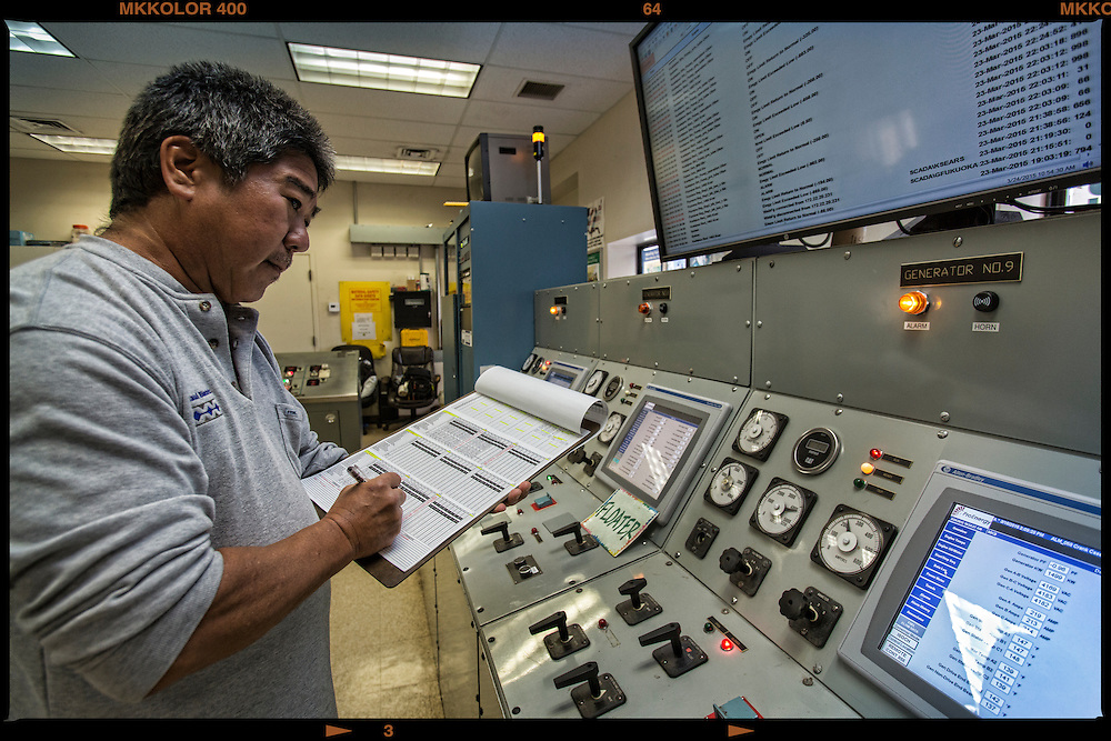 Todd Tamanaha, Chief Operator for 12 years checks the system in the MECO Molokai power plant control room.