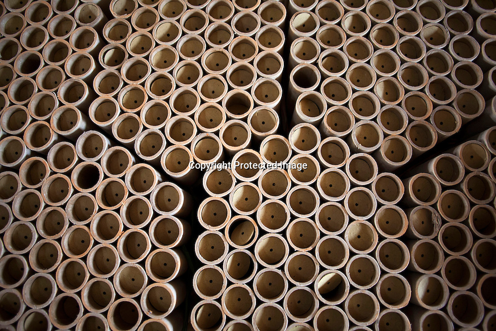 Hunan, Liuyang, Dec. 19..2013 :  freshly glued firecracker tubes are dried on the factory gound .