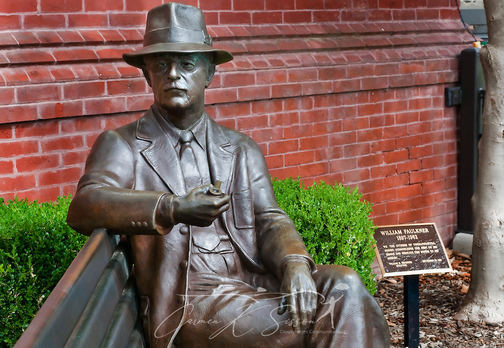 A bronze statue of William Faulkner looks out over Courthouse Square, July 17, 2011, in Oxford, Mississippi. (Photo by Carmen K. Sisson/Cloudybright)