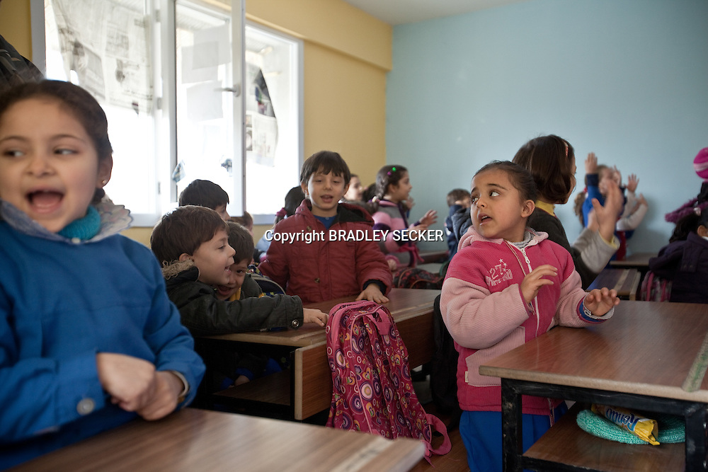 Syrian students during a class warm up at the Albashayer School for Syrian refugee children, Antakya, Turkey. 14/12/2012. Bradley Secker for The Washintgon Post
