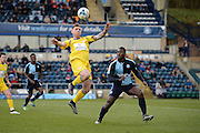 Accrington forward Billy Kee gets to the ball ahead of Wycombe defender Aaron Pierre during the Sky Bet League 2 match between Wycombe Wanderers and Accrington Stanley at Adams Park, High Wycombe, England on 30 April 2016. Photo by David Charbit.