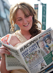 LIVERPOOL, ENGLAND - Friday, April 9, 2010: A race-goes check the form in the Racing Post on Ladies' Day during the second day of the Grand National Festival at Aintree Racecourse. (Pic by David Rawcliffe/Propaganda)