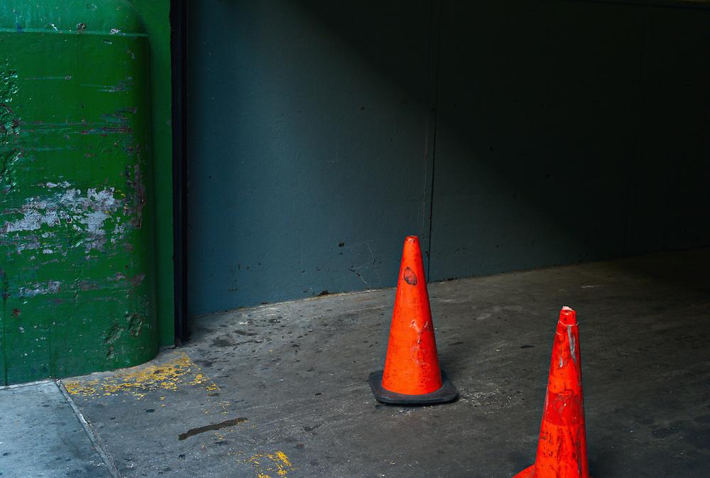 Orange traffic cones in empty loading dock driveway, Midtown Manhattan, New York, US