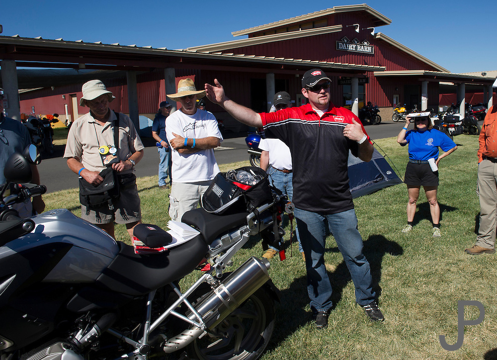 A Warn Winch employee demonstrates how to use a Warn Winch on a BMW GS motorcycle.