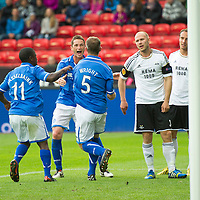 Rosenborg v St Johnstone....18.07.13  UEFA Europa League Qualifier.<br /> FRAZER WRIGHT CELEBRATES WITH GARY MCDONALD AND NIGEL HASSELBAINK AS MIKAEL DORSIN REACTS<br /> Picture by Graeme Hart.<br /> Copyright Perthshire Picture Agency<br /> Tel: 01738 623350  Mobile: 07990 594431