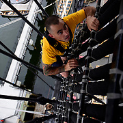 BOSTON -- SEPT 11, 2019 -- Chief Builder Roger Hakins of Ansonia, Connecticut climbs the main mast rigging aboard USS Constitution as part of heritage training with Greater New England Chiefs Mess. <br /> Across the U.S. Navy every year, Chief Petty Officers train 1st Class Petty Officers who have been selected for promotion in a summer-long training program. The Final Week, in the week leading up to the pinning ceremony in mid-September, is filled with important training events. <br /> This year, the Greater New England Chiefs Mess met for their first two days of Final Week training at USS Constitution, at Charlestown Navy Yard in Boston. Greater New England Chiefs Mess is made up of Reserve Chiefs from seven Navy Reserve Operational Support Centers, all within four hours drive of Boston. USS Constitution is the world's oldest commissioned warship.  <br /> U.S. Navy Photo by Chief Mass Communication Specialist Roger S. Duncan