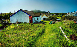 Easdale Island, the smallest permanently-inhabited island of the Inner Hebrides, Scotland.  The building on the left houses the island's museum.<br /> <br /> (c) Andrew Wilson | Edinburgh Elite media