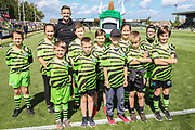 FGR Ambassadors with Forest Green Rovers Liam Shephard(2) during the EFL Sky Bet League 2 match between Forest Green Rovers and Grimsby Town FC at the New Lawn, Forest Green, United Kingdom on 17 August 2019.