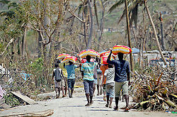 October 9, 2016 - HTI - Young men carry bags of rice they got from a food distribution center to their families near Port Salut, Haiti on Sunday, Oct. 9, 2016. (Credit Image: © Patrick Farrell/TNS via ZUMA Wire)