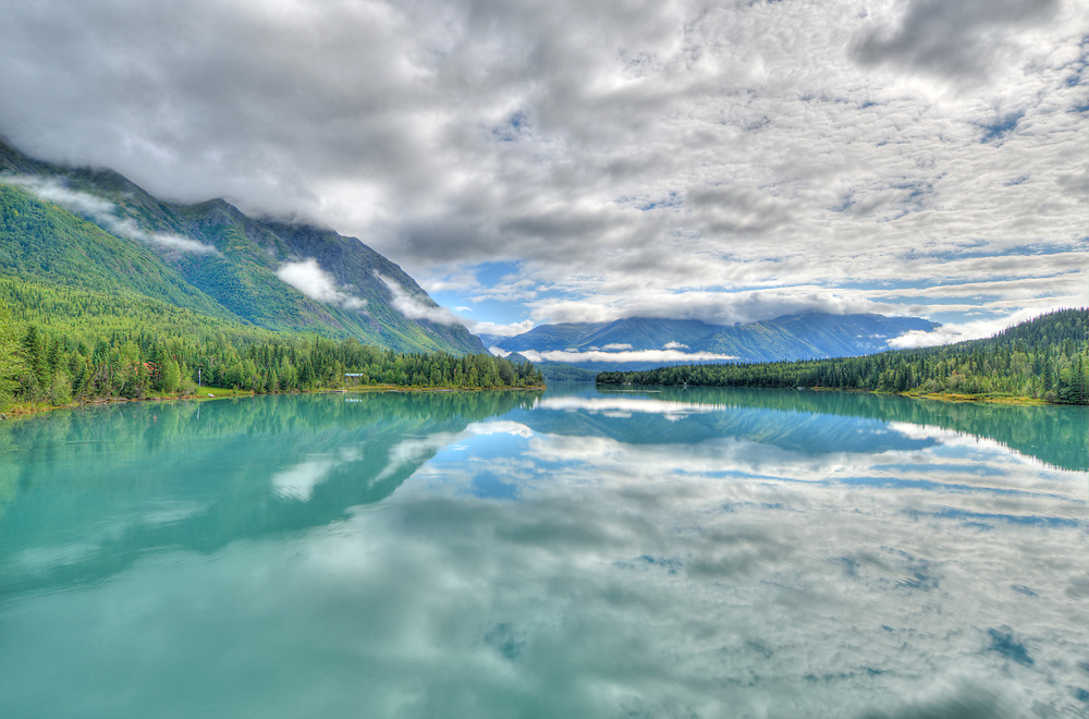 A scenic view overlooking teal colored Kenai Lake in Alaska.