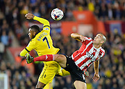 Aston Villas Leandro Bacuna and Southamptons Oriol Romeu challenge in the air during the Capital One Cup match between Southampton and Aston Villa at the St Mary's Stadium, Southampton, England on 28 October 2015. Photo by Adam Rivers.