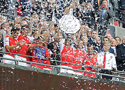 Arsenal's Mikel Arteta Lift's the community shield  - Photo mandatory by-line: Joe Meredith/JMP - Mobile: 07966 386802 10/08/2014 - SPORT - FOOTBALL - London - Wembley Stadium - Arsenal v Manchester City - FA Community Shield