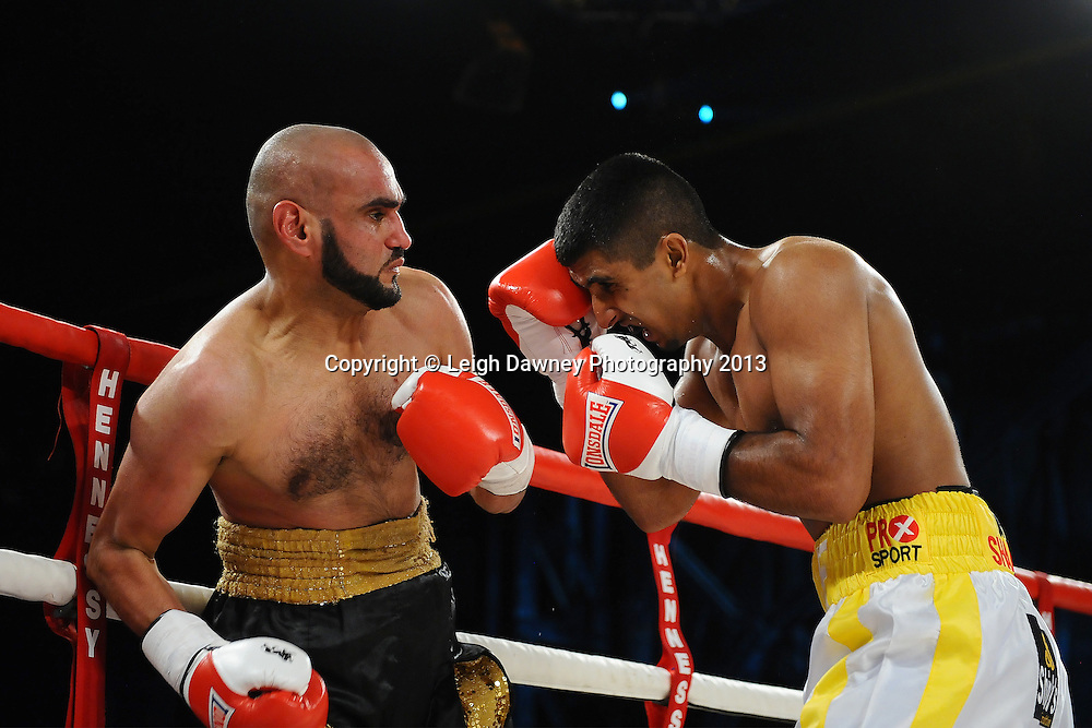 Atif Shafiq (right) defeats Sid Razak. Saturday 14th September 2013 at the Magna Centre, Rotherham. Hennessy Sports. Self billing applies. © Credit: Leigh Dawney Photography.