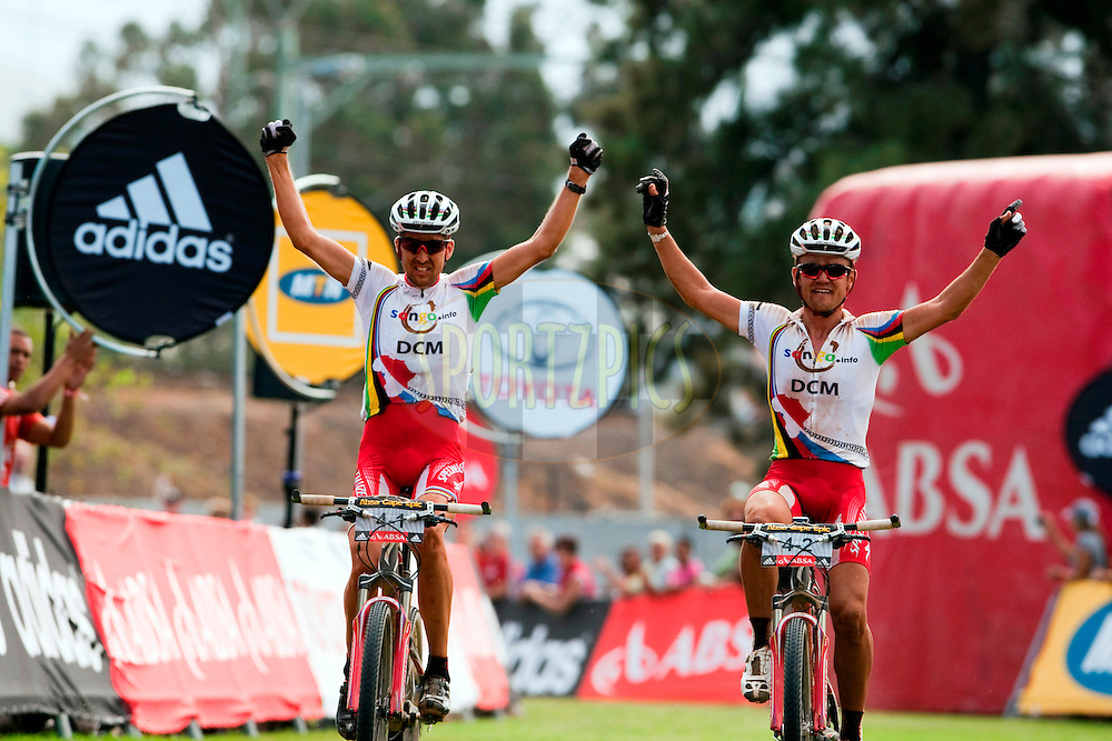 Christoph Sauser and Burry Stander of Songo Specialized by DCM celebrate winning stage four of the 2010 Absa Cape Epic Mountain Bike stage race from Ceres to Worcester in the Western Cape, South Africa on the 24 March 2010.Photo by Gary Perkin/SPORTZPICS