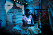 Kamisa Peter, 15, poses in her shelter at the CoP camp in in Juba, South Sudan, March 2, 2015. (For UNICEF)
